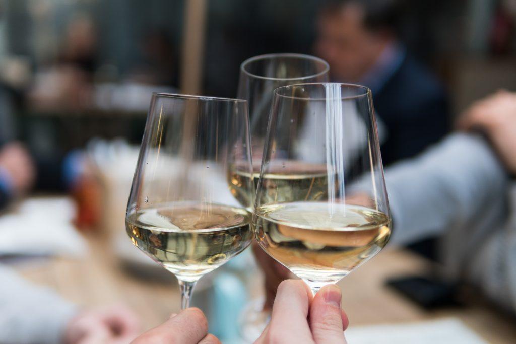 Three white wine glasses