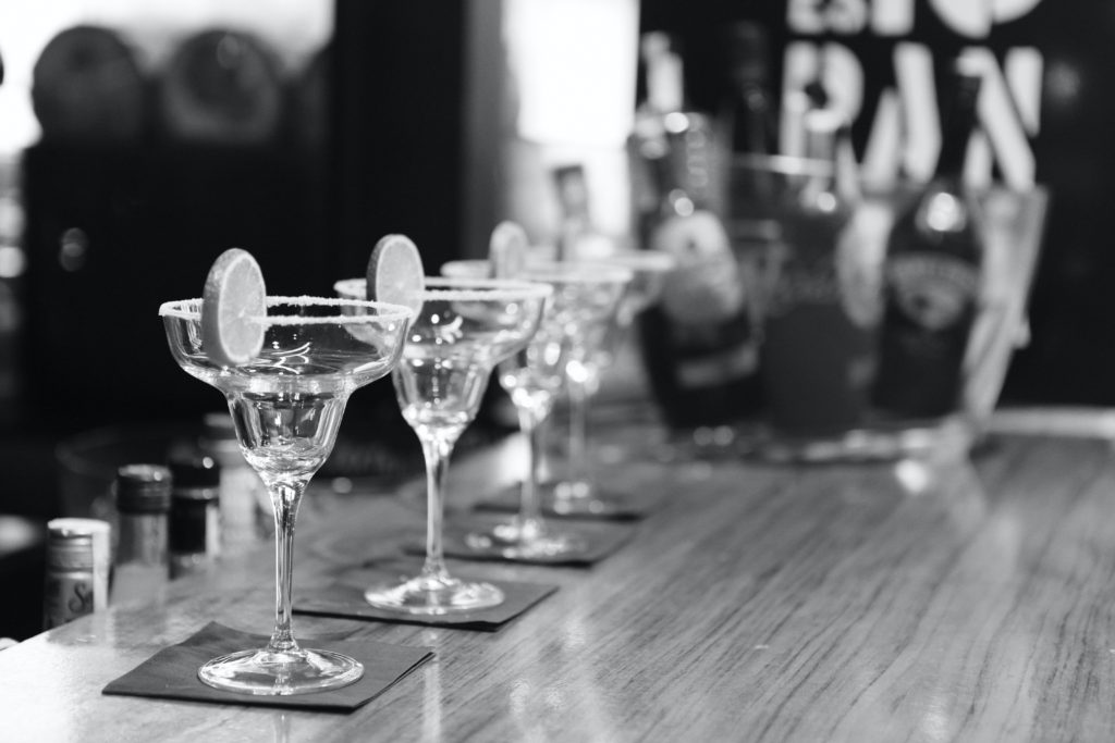 black and white picture  of cocktails on bar