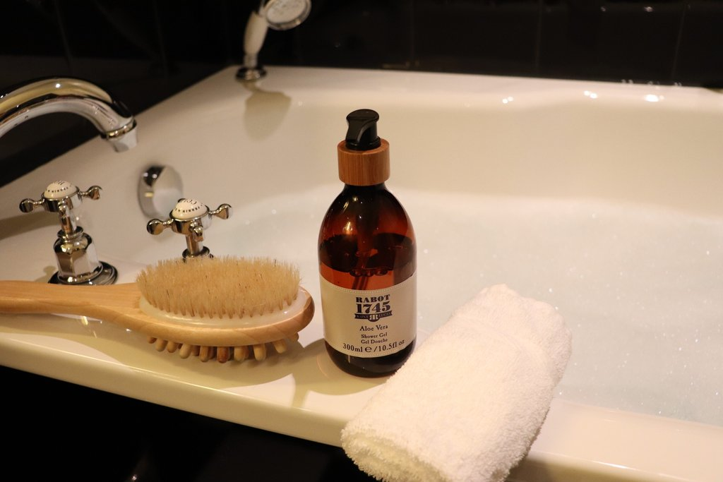 Rabot 1745 bottle next to bath