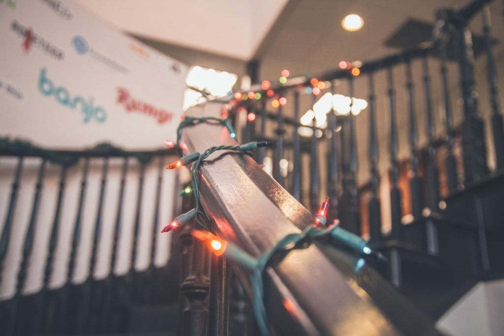 office banister with christmas lights