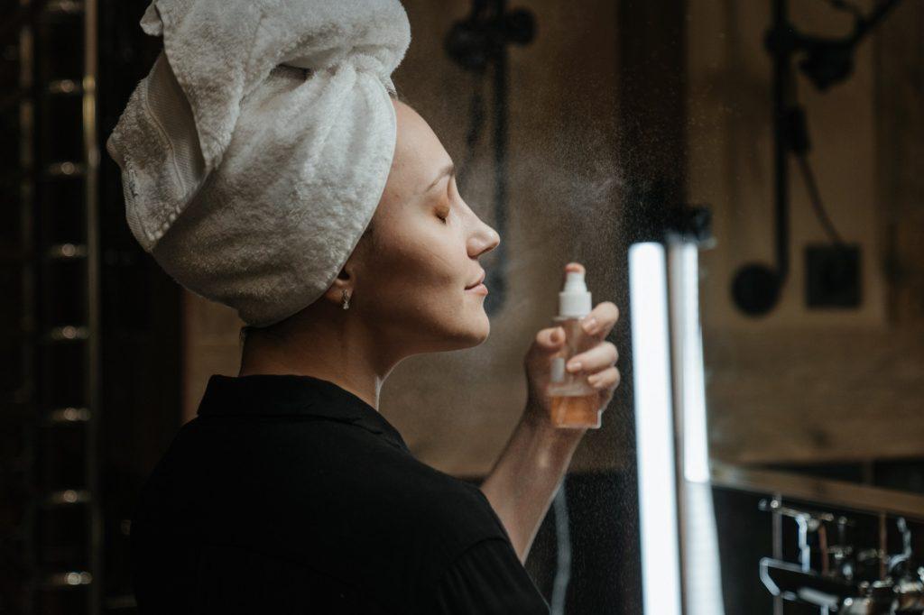 woman spraying face