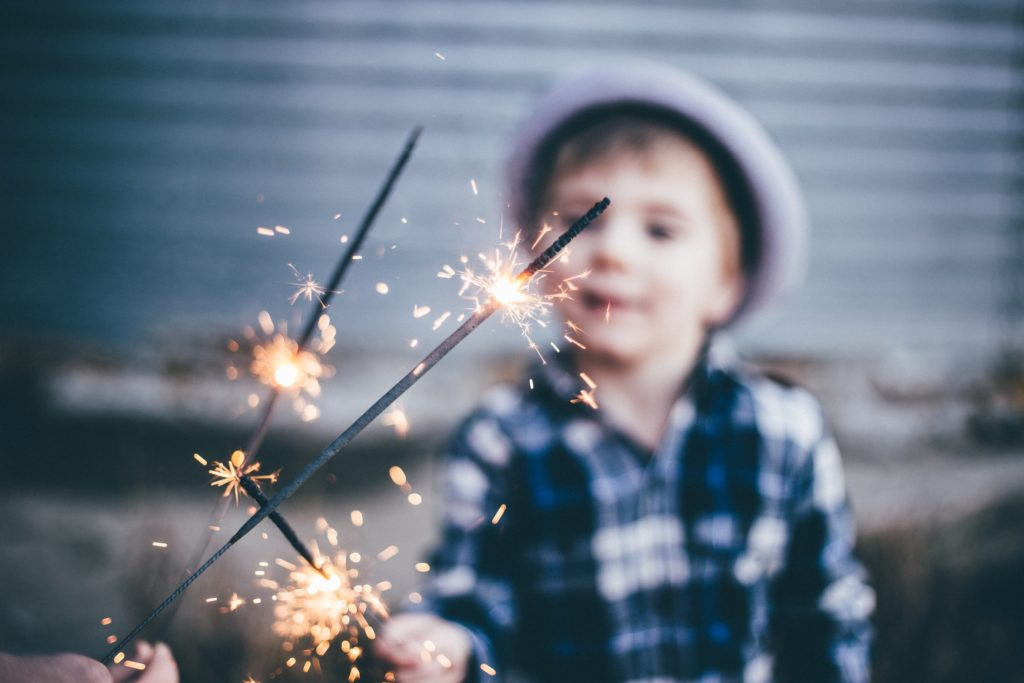 kid with sparklers