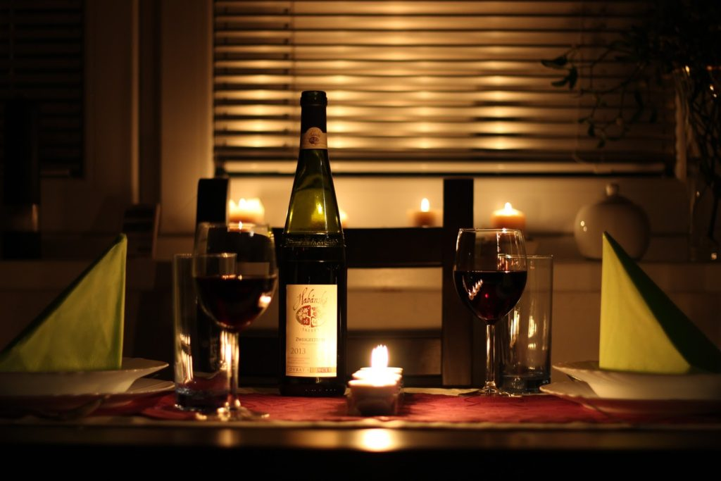Romantic table setting with wine and candles