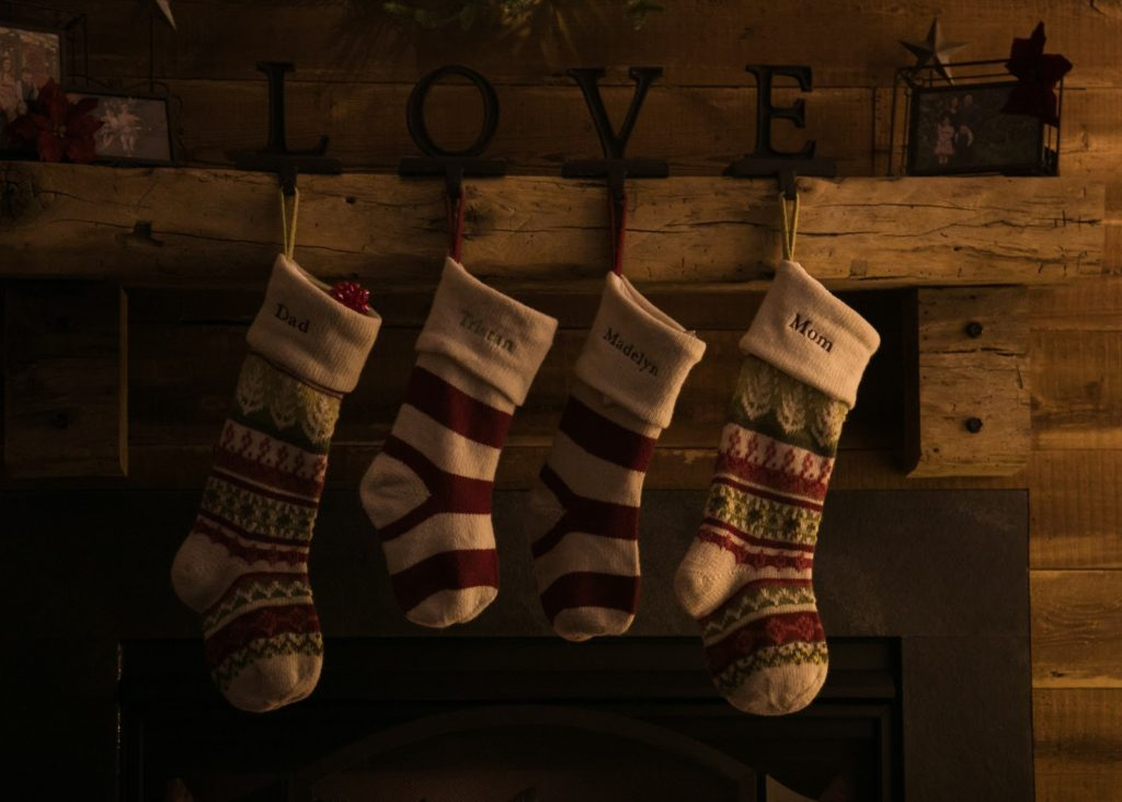 Family Christmas stockings hanging from shelf