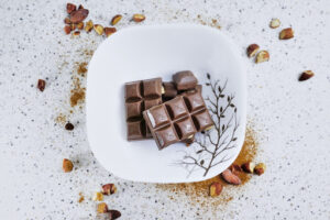 Chocolate in a bowl with almonds
