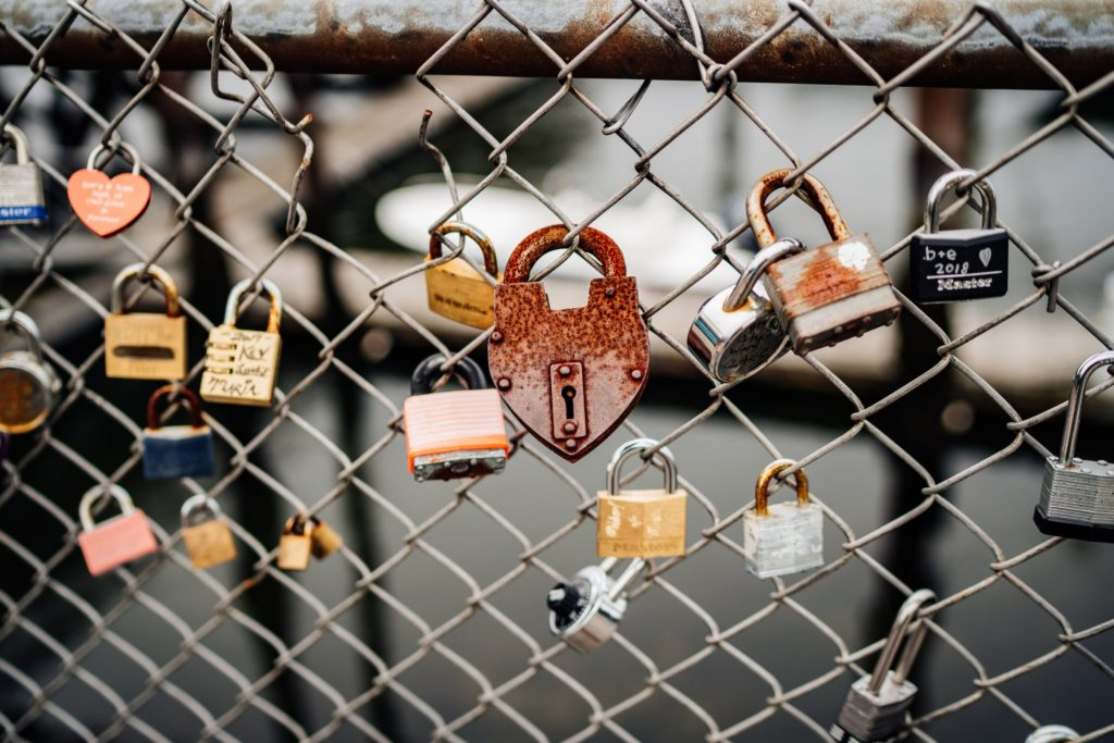 padlocks attached to a fence