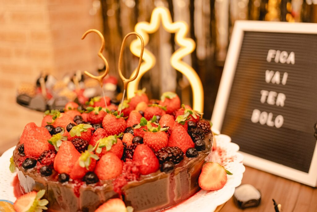 chocolate cake with strawberries and other fruit on it