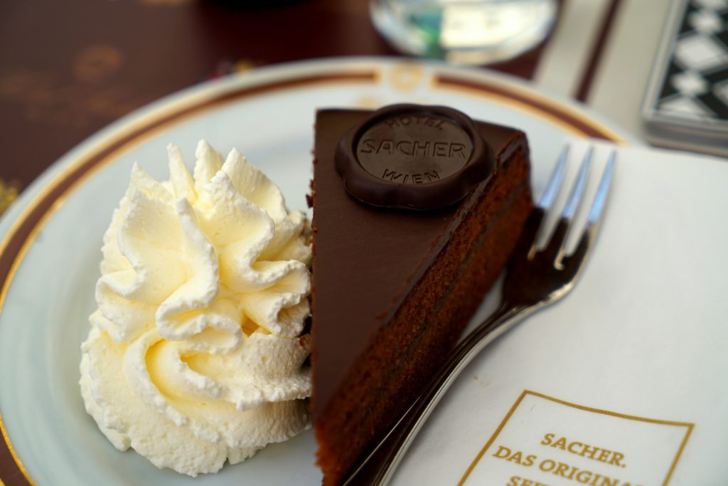 Sacher torte on a plate with whipped cream