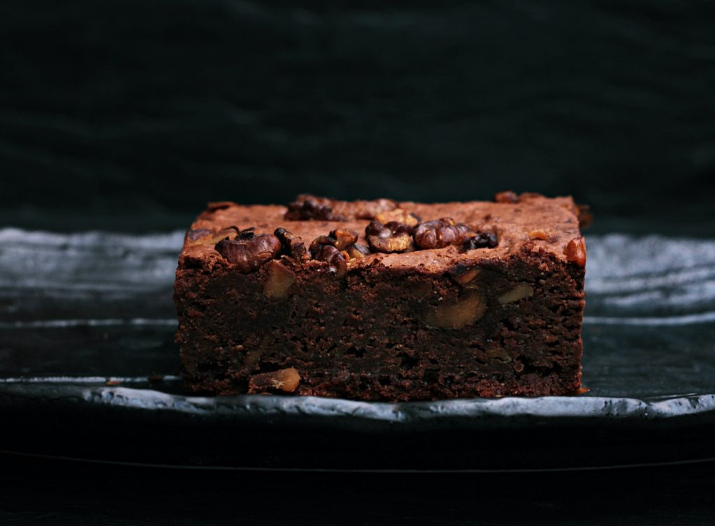 Brownie square on a black plate