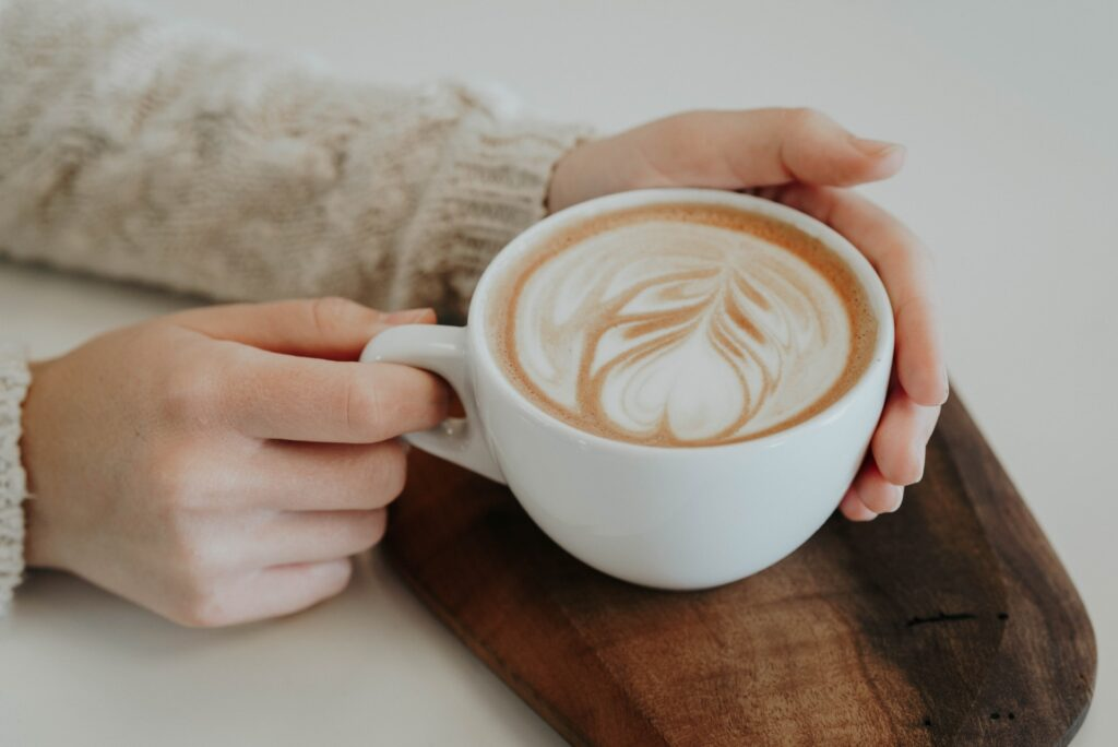 hands holding a latte