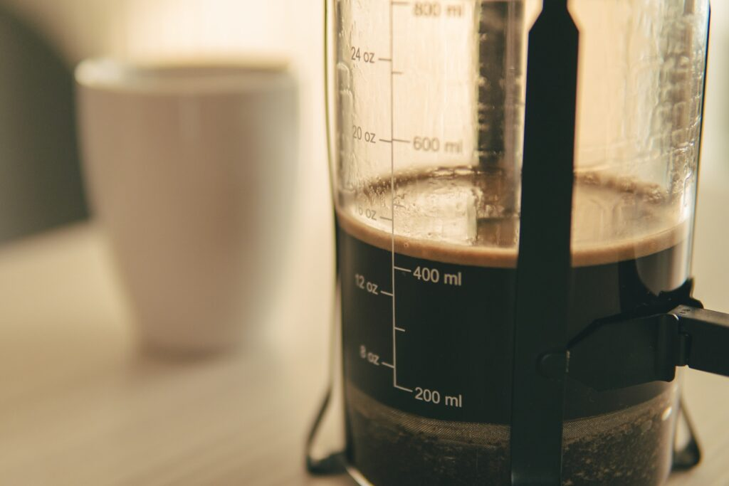 cafetiere with strong coffee to make a latte