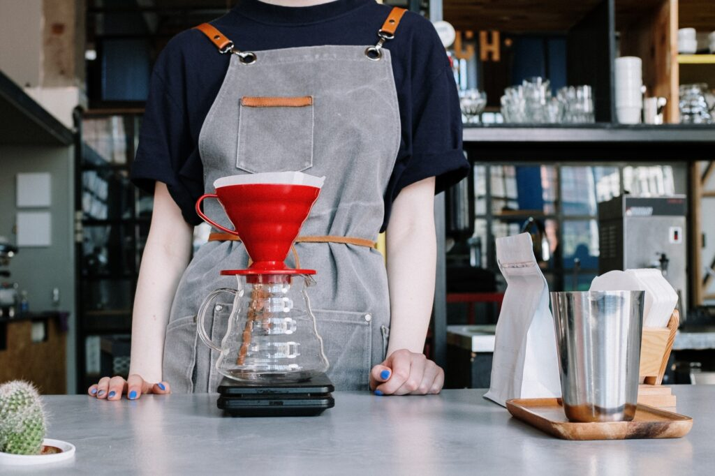 barista making filtered coffee on scales