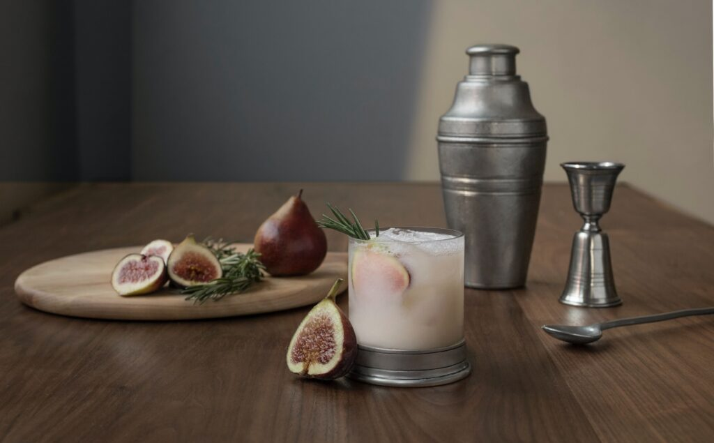 fig cocktail next to cocktail equipment
