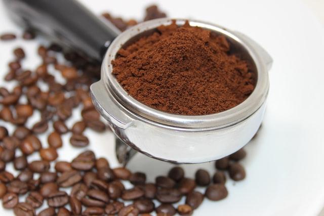 Ground coffee in an espresso machine handle